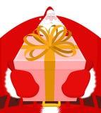 De kerstman geeft Kerstmisgift De vriendelijke grootvader overhandigt doos met boog Royalty-vrije Stock Fotografie