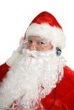 De kerstman luistert aan Hoofdtelefoons royalty-vrije stock foto's