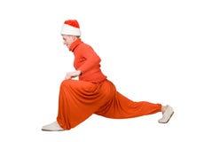 De Kerstman maakt yoga Stock Afbeelding