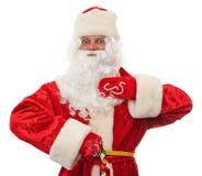 De kerstman meet de zijn taille Royalty-vrije Stock Fotografie