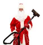 De Kerstman met een stofzuiger Stock Foto's