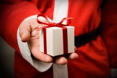 De Kerstman met gift Stock Afbeeldingen