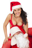 De Kerstman met sexy meisje Royalty-vrije Stock Afbeeldingen