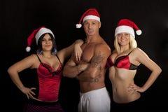 De Kerstman met twee Meisjes Royalty-vrije Stock Afbeeldingen