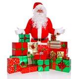 De Kerstman met verpakte gift stelt voor Royalty-vrije Stock Afbeeldingen