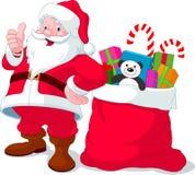 De Kerstman met zakhoogtepunt van giften Stock Foto's