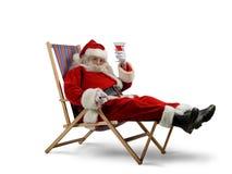 De Kerstman ontspant Stock Foto