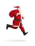 De Kerstman op de looppas Stock Foto