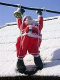 De Kerstman op een dak Royalty-vrije Stock Afbeelding