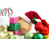 De Kerstman van het spaarvarken met geïsoleerde ornamenten Royalty-vrije Stock Afbeeldingen