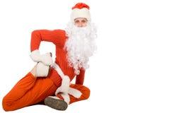 De Kerstman zit bij zich halve streng en het uitrekken Royalty-vrije Stock Afbeeldingen