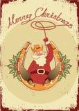 De kerstman zit op hoef met cowboylasso Stock Afbeelding