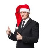 De kerstmanzakenman zonder glimlach het tonen beduimelt omhoog Stock Fotografie