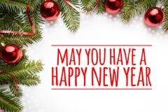 De Kerstmisdecoratie met groet ` Mei u hebben een gelukkig nieuw jaar ` Stock Fotografie
