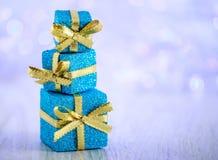De Kerstmisgiften schitteren achtergrond met exemplaarruimte Vrolijke Kerstmis en Gelukkig Nieuwjaar Stock Afbeelding