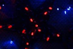 De Kerstmislichten, kunnen als achtergrond gebruiken Royalty-vrije Stock Afbeelding