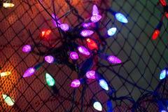 De Kerstmislichten, kunnen als achtergrond gebruiken Stock Foto's