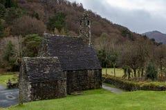 De Keuken van heilige Kevin bij de Kloosterplaats van Glendalough in Wicklow, Ierland stock foto