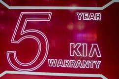 ` de KIA logotipo de Motor Company del ` de la garantía de 5 años Imagen de archivo