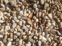 De kiezelstenen, stenen, rotsen, wasten opgepoetste kiezelstenen Stock Foto