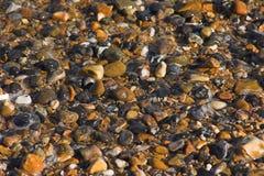 De kiezelstenen van het strand stock foto's