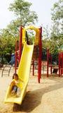 De kinderen glijden Royalty-vrije Stock Fotografie