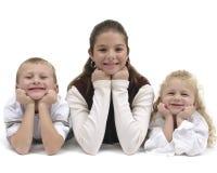 De kinderen groeperen zich Stock Afbeelding