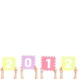 De kinderen houden het nieuwe jaar van 2012 Royalty-vrije Stock Afbeeldingen