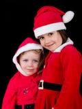 de kinderen kleedden zich in de kostuums van Kerstmissanta stock afbeeldingen