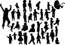 De kinderen silhouetteren Stock Foto