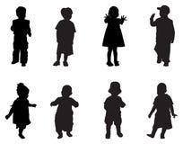 De kinderen silhouetteren Stock Afbeeldingen