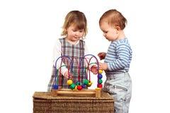 De kinderen spelen samen Stock Foto's