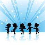 De kinderen van silhouetten Stock Foto