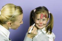 De kinderen zien het schilderen onder ogen Royalty-vrije Stock Foto's