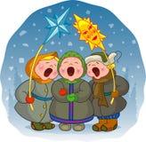 De kinderen zingen een lied van Kerstmis Stock Foto