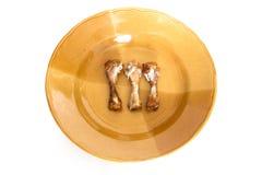 De kip beent drie Stuk op een plaat uit Stock Foto