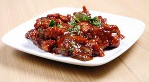 De kip van Spaanse pepers in plaat Stock Foto's