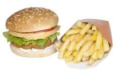 De kippenhamburger en spaanders van de voedselvoorraad Stock Fotografie