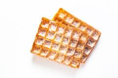 De Klassieke vierkante Wafels van het voedselconcept met suikerglazuur die sugat op w toping stock afbeelding