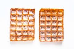 De Klassieke vierkante Wafels van het voedselconcept met suikerglazuur die sugat op w toping stock foto's