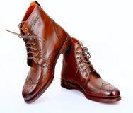 De kledingslaarzen van de Wingtip donkere die Spaanse peper op wit worden geïsoleerd Stock Foto