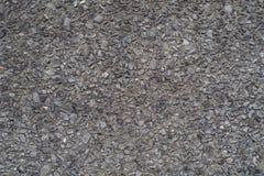 De kleine achtergrond van het het asfalt concrete patroon van de rotsen donkere textuur Stock Afbeeldingen