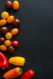 De kleine Achtergrond van Tomatoe en van de Peper Stock Foto's