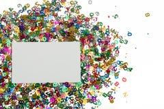 De kleine confettien van kleurenaantallen op wit Stock Afbeeldingen