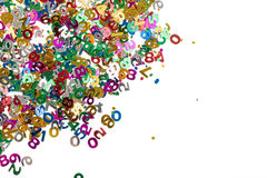 De kleine confettien van kleurenaantallen op wit Royalty-vrije Stock Foto