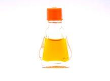 De kleine fles van het parfumglas isoleert Stock Foto