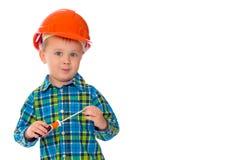 De kleine jongen in de helm van de bouwer Royalty-vrije Stock Afbeelding
