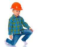 De kleine jongen in de helm van de bouwer Royalty-vrije Stock Foto