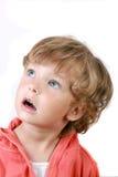 De kleine jongen met de verraste uitdrukking Royalty-vrije Stock Afbeeldingen
