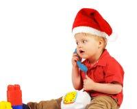 De kleine jongen van de Kerstman Stock Foto's